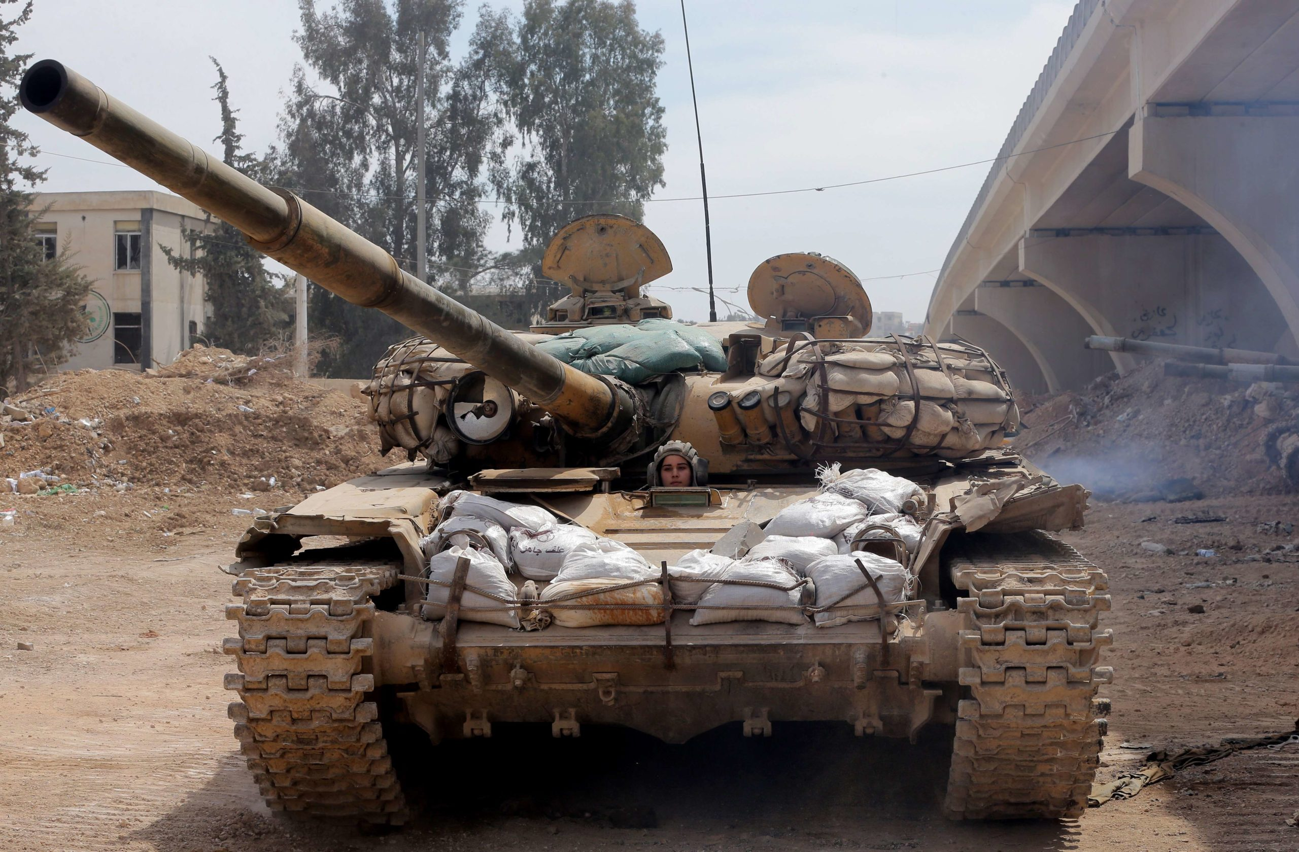 A female Syrian soldier from the Republican Guard commando battalion drives a tank during clashes with rebels in the restive Jobar area, in eastern Damascus, on March 25, 2015. The female battalion, which was created nearly a year ago, consists of 800 female soldiers who are positioned in the suburbs of the Syrian capital where they monitor and secure the frontlines with snipers, rockets and machine guns. AFP PHOTO / JOSEPH EIDJOSEPH EID/AFP/Getty Images